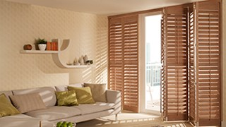 Hillary's natural wood shutters are warm and stylish
